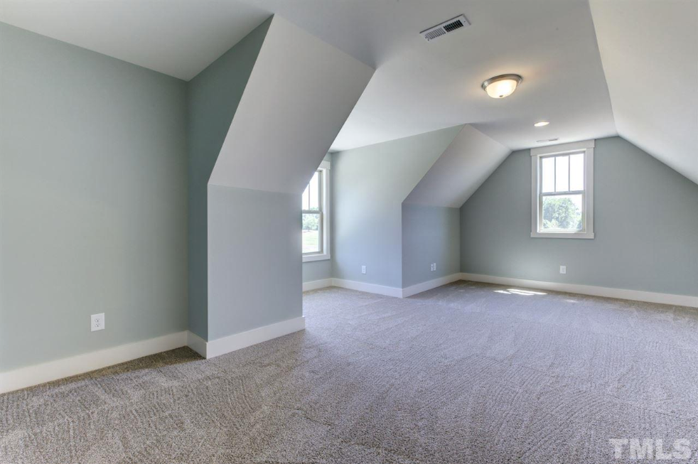 large carpeted bonus room in a fuquay varina new construction home