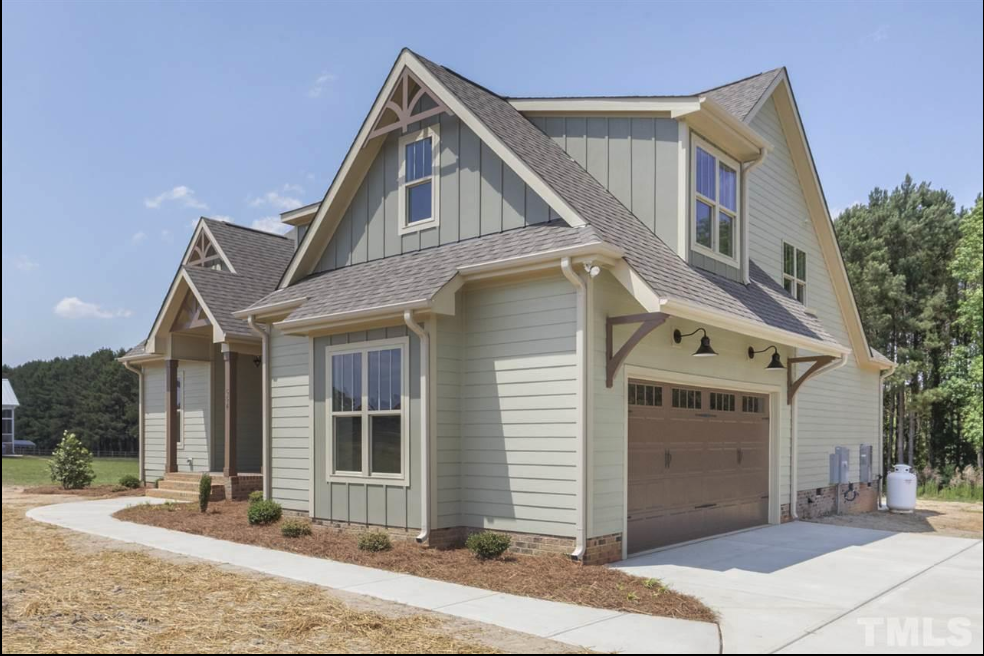 exterior of a beautiful new construction home  for sale in fuquay varina
