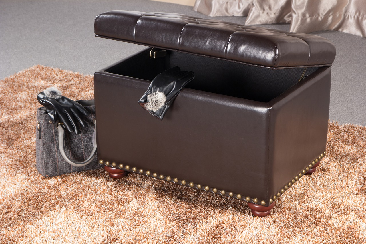 storage ottoman hiding clutter when selling during back-to-school