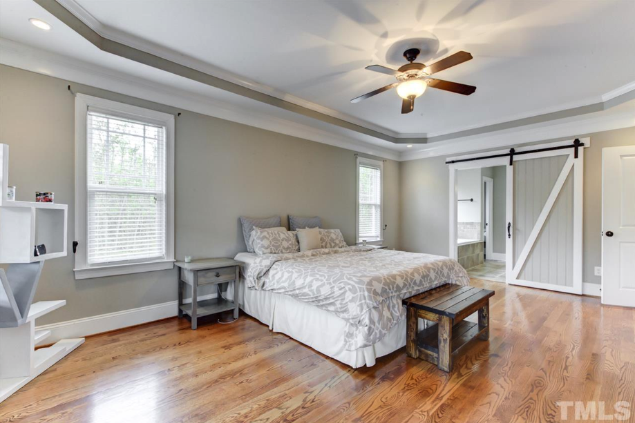 a huge master bedroom at 14550 NC 210 Highway, an Angier luxury home for sale