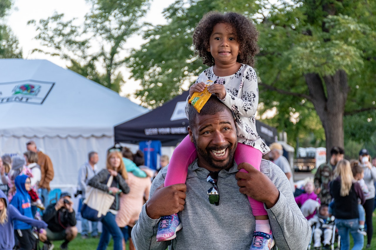 father and daughter having fun at a fuquay varina event