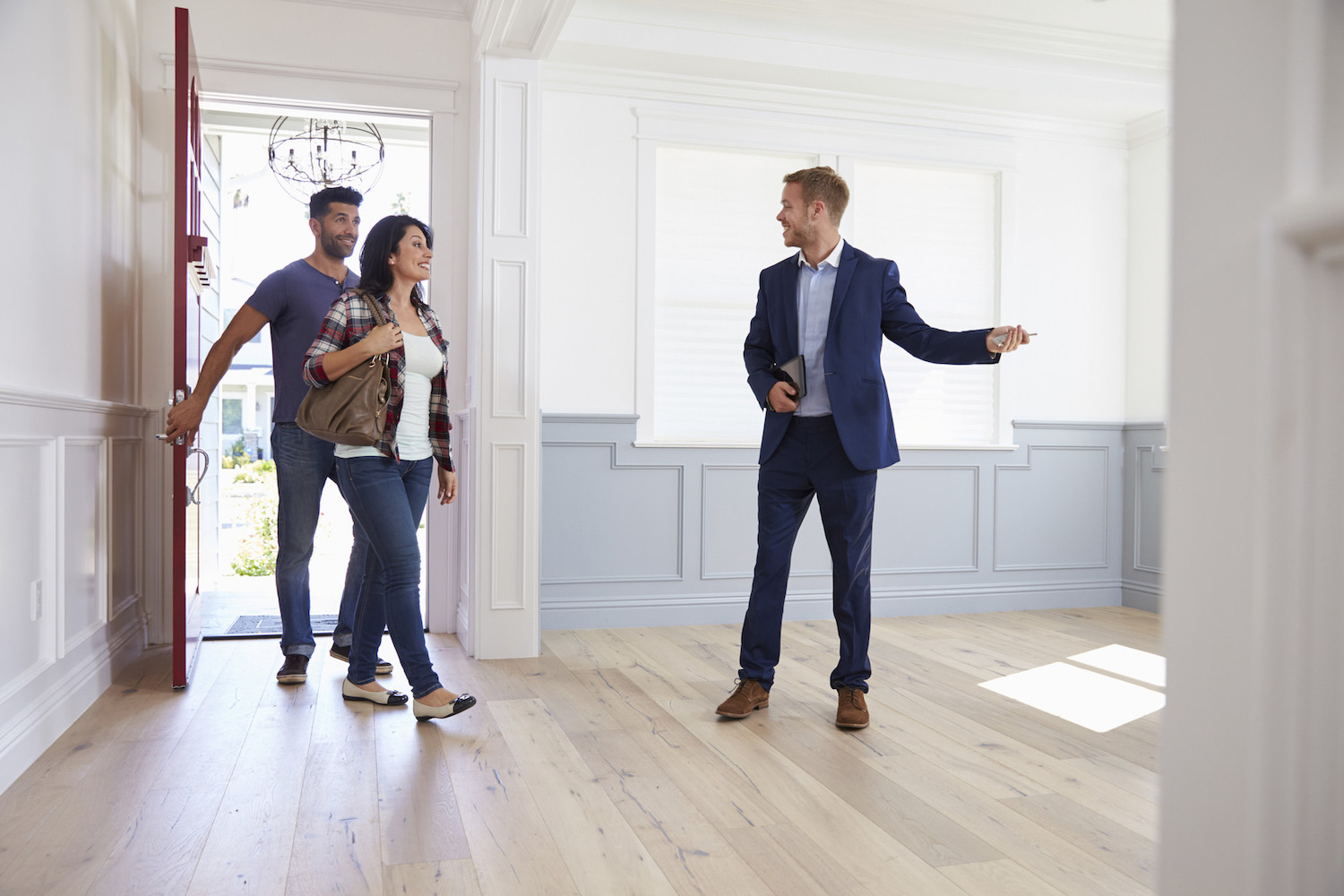 realtor taking buyers on a tour