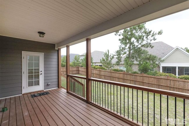 view of fenced backyard from the dec k of 345 rhoda lilley drive in fuquay varina