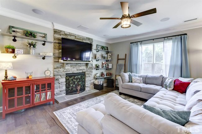 family room of 8120 purple aster drive