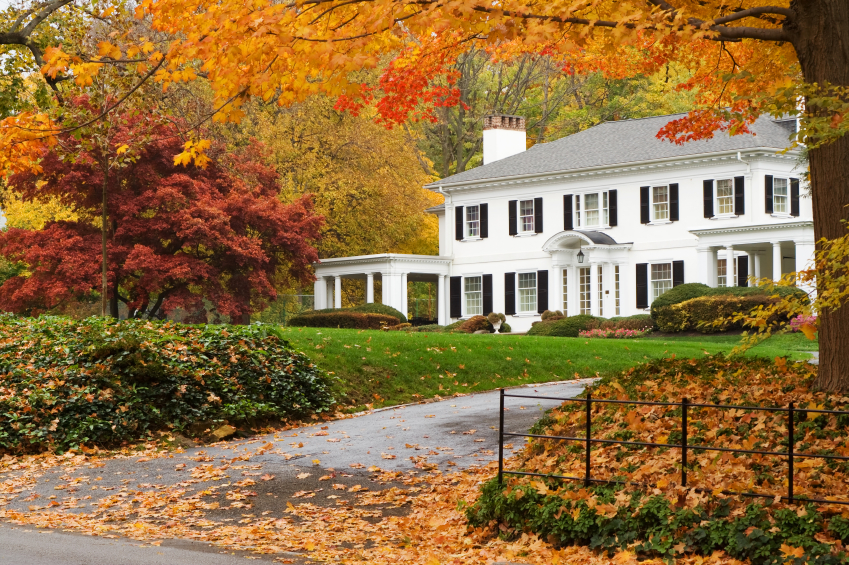 a beautiful home surrounded by fall foliage