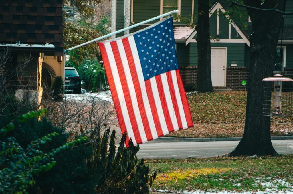 An American flag in a safe neighborhood, a factor drawing in many millennials to buy a home.
